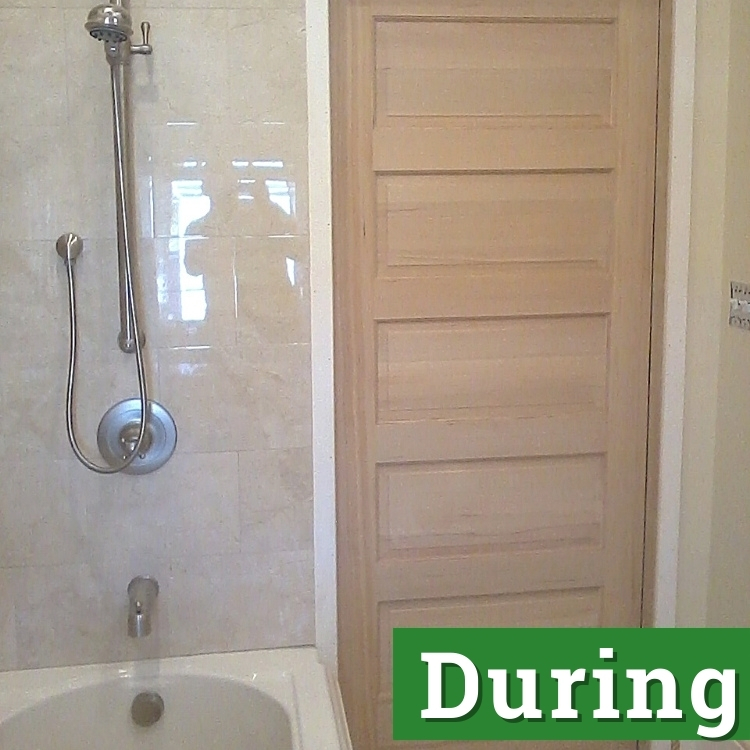a wooden bathroom door before it is painted white