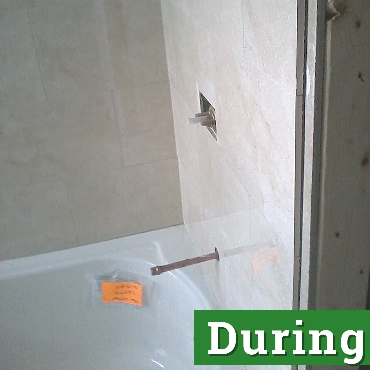 a newly installed bathtub and water pipes for shower extensions