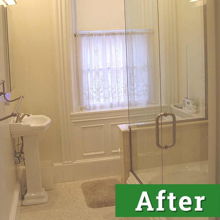 a newly remodeled bathroom with a glass enclosed tub