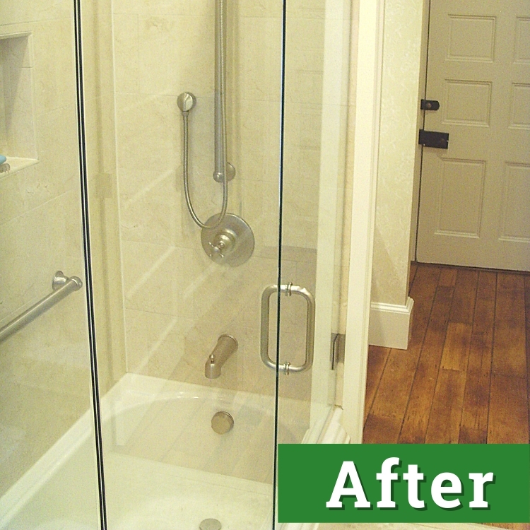 the glass door and enclosure of a newly installed bathtub