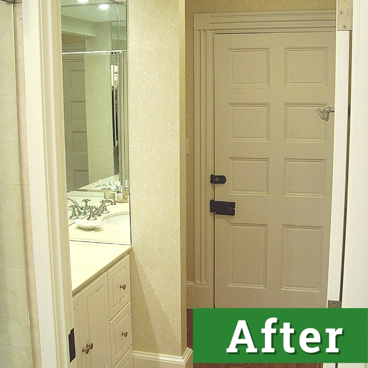 newly installed bathroom cabinetry and painted door