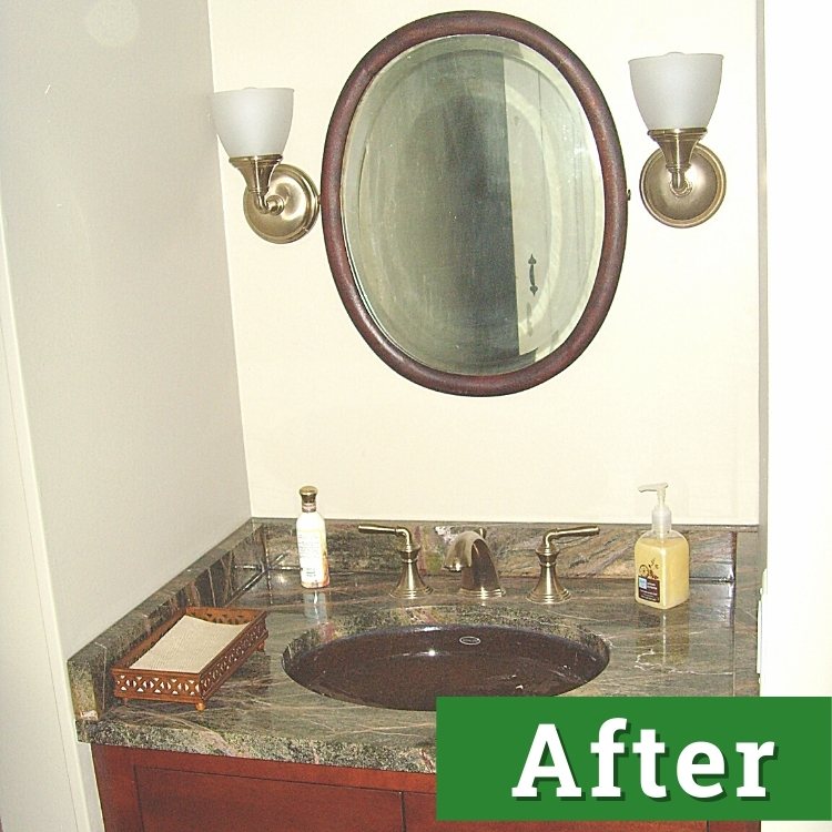 a renovated bathroom with dark oak accents and cabinetry