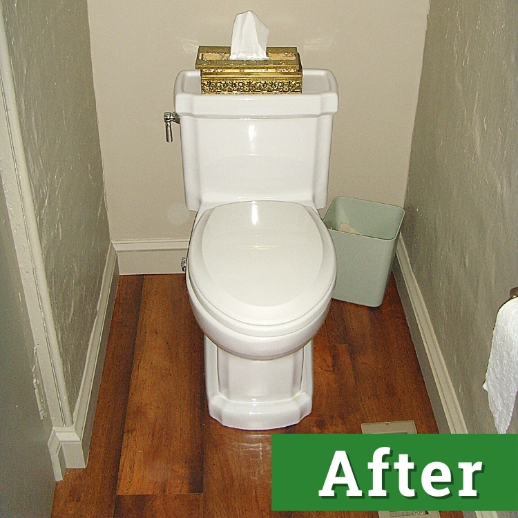 a newly installed white toilet on hard wood flooring