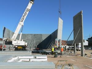 Crane setting up precast concrete