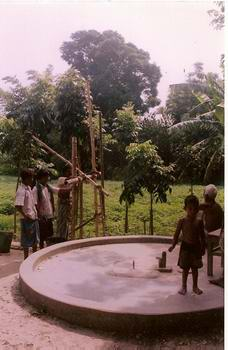 Kids Playing Near a Tube Well