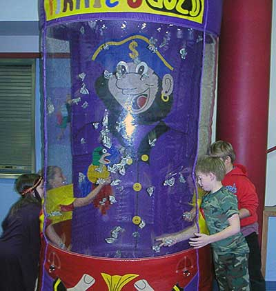 Kids playing in a money machine.