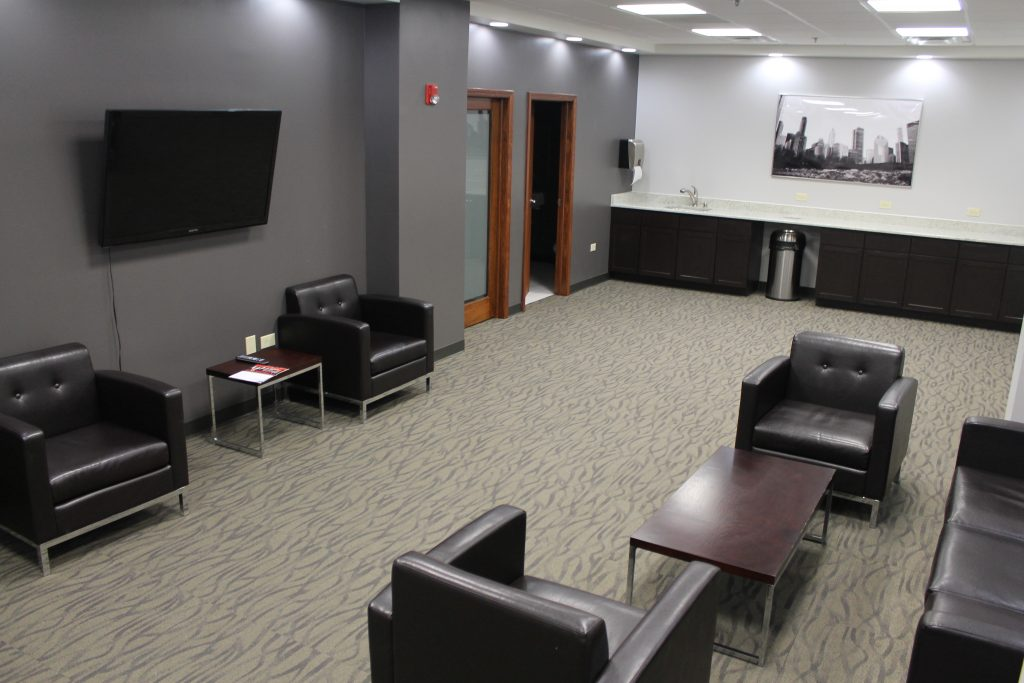 Weiss Properties Wifi Center lounge with chairs, TV, and counter space