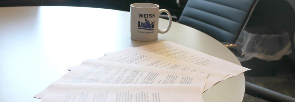 forms on a table with Weiss Properties Mug in background