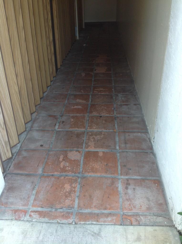 badly damaged exterior saltillo tiles
