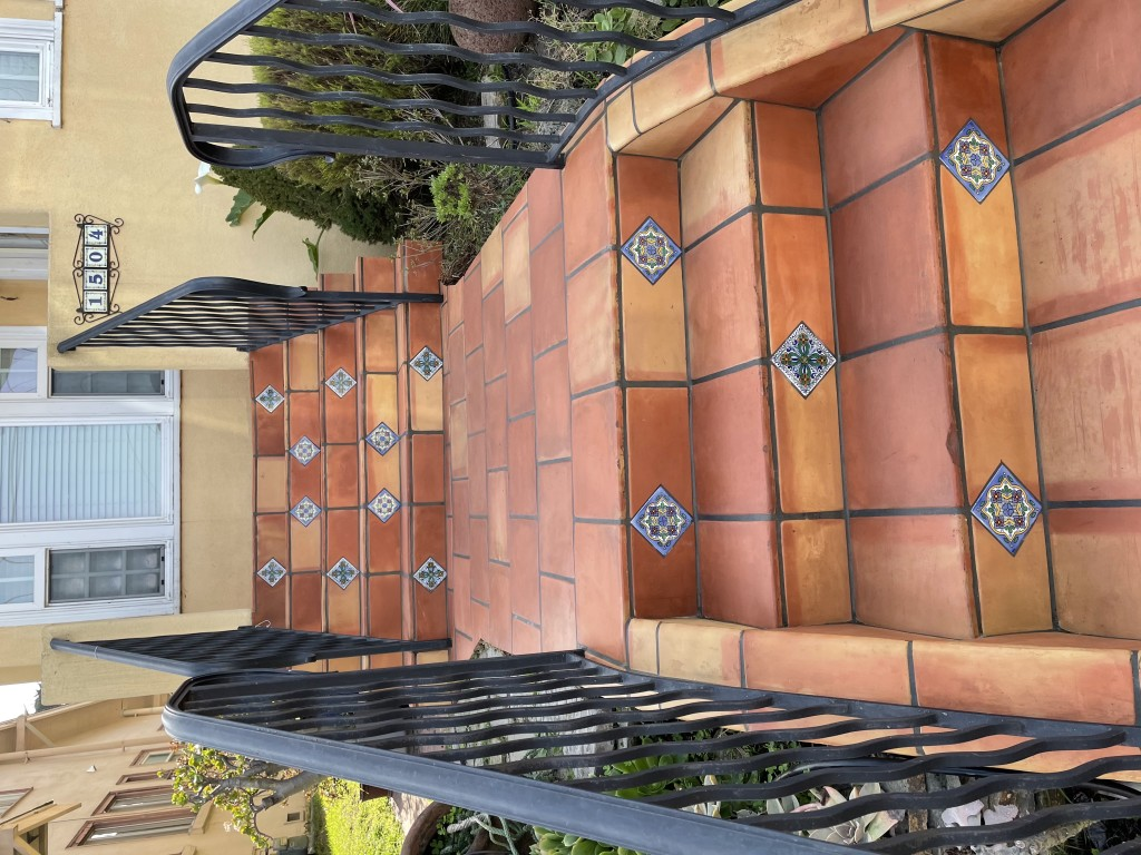 outdoor saltillotile stair entryway with talavera