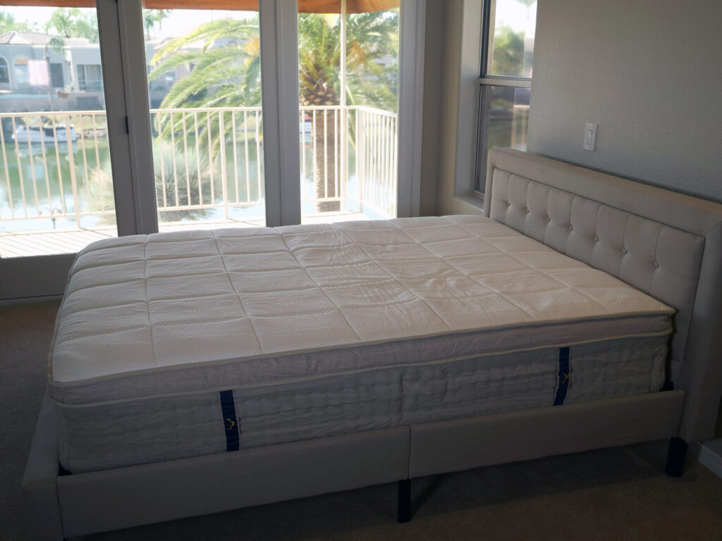 DreamCloud mattress on bed frame