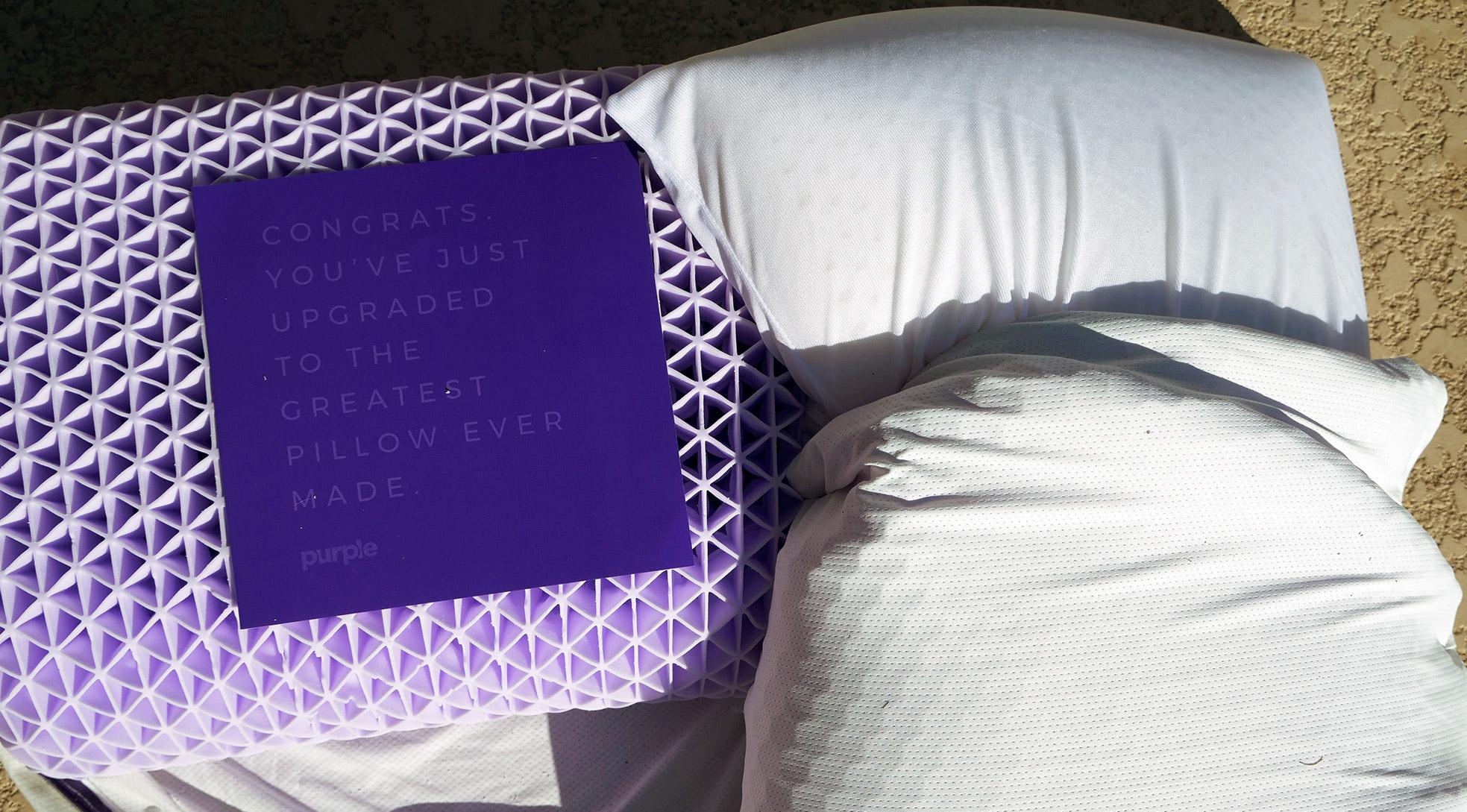 purple pillow on left purple harmony pillow on right