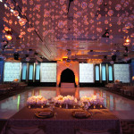 This amazing Indian wedding married Hindu traditions with modern technology. Tradition prevailed with a colorful Indian rehearsal dinner; a lively processional to introduce the two families and an elaborate ceremonial wedding overlooking the ocean. East merged with West at a reception that included a live theatrical production complete with digital mapping, video projection, music, and scenes!