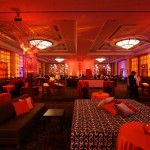 This holiday celebration was gift-wrapped with a colorful twist. Our client wanted a holiday event, but didn't want a traditional, expected look. The solution? CranTango! A celebration of a different color. Dramatic lighting in cranberry and tangerine combined to create an event with a warm welcoming atmosphere as the ballroom appeared to be gift-wrapped from the inside out.