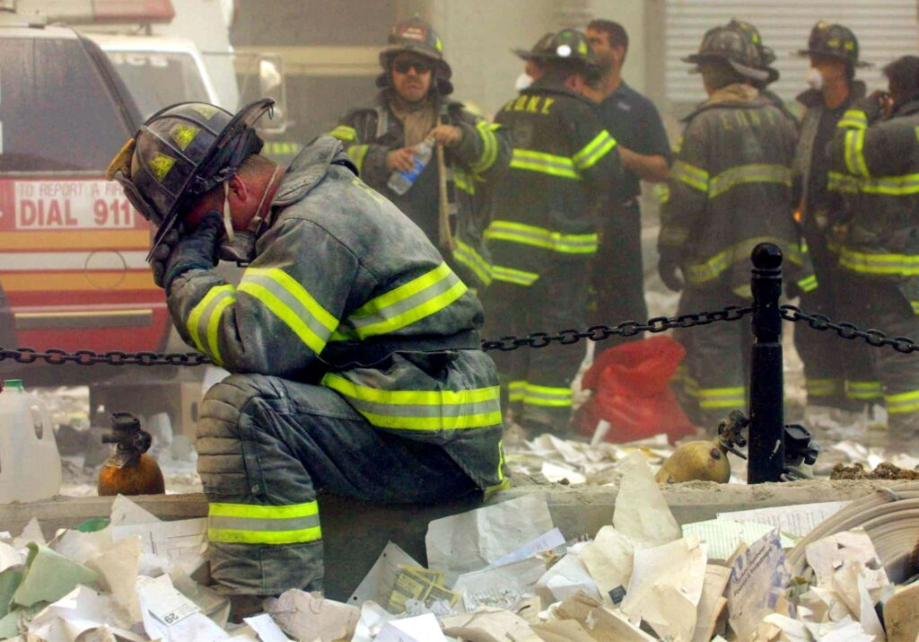 A firefighter grieves at the 9/11 site                                                                  Mario Tama/Getty Images