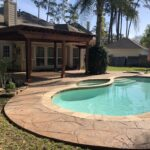 Stamped Concrete and Poolside Pergola