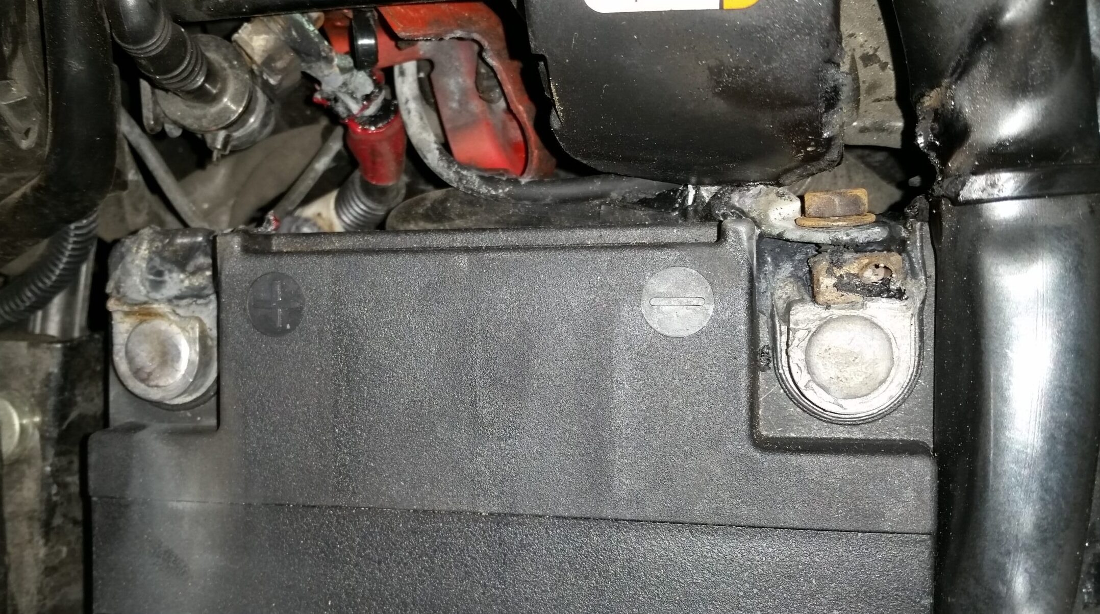 Battery installed without spacers melted down both battery terminals