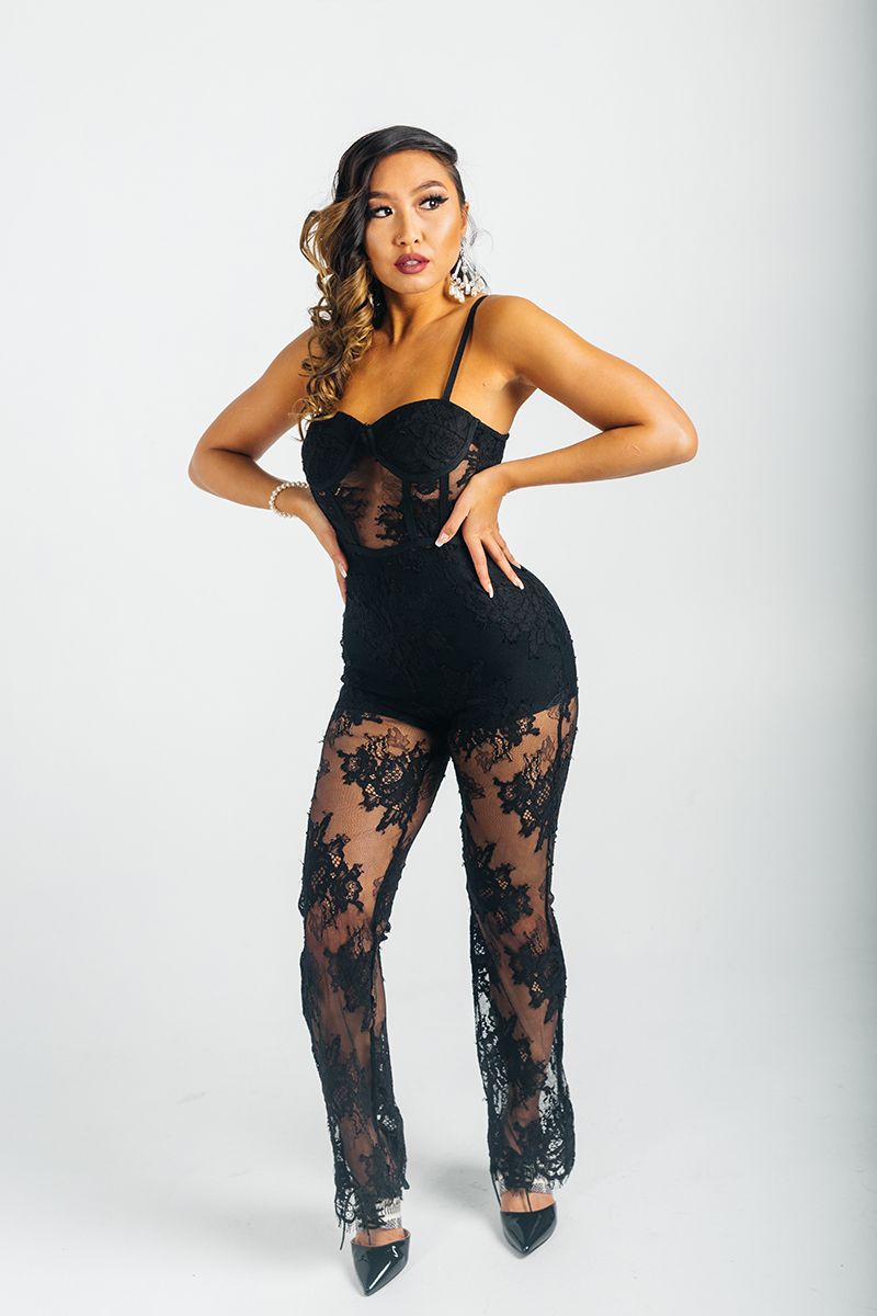 A beautiful young brunette model poses for a RAW Photographic Studio photography session in Denver Colorado wearing a black lace pant suit