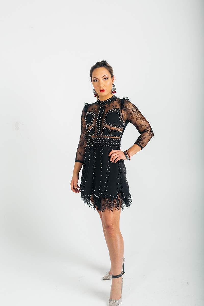 A beautiful young brunette model poses for a RAW Photographic Studio photography session in Denver Colorado wearing a a black lace dress