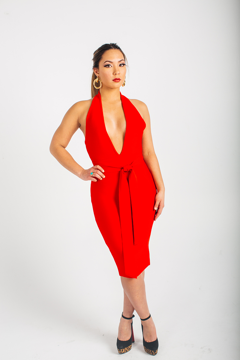 A beautiful young brunette model poses for a RAW Photographic Studio photography session in Denver Colorado wearing a red dress