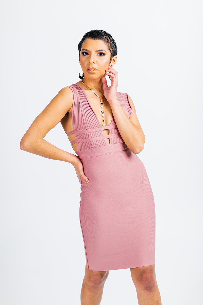 A beautiful young brunette model poses for a RAW Photographic Studio photography session in Denver Colorado wearing a mauve dress