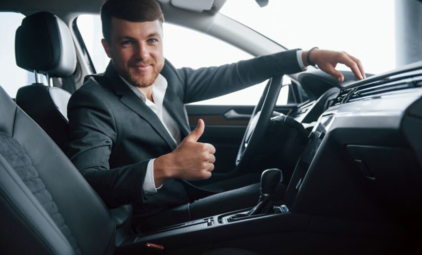 Person buying car - pre-owned car dealership - PCH Auto World