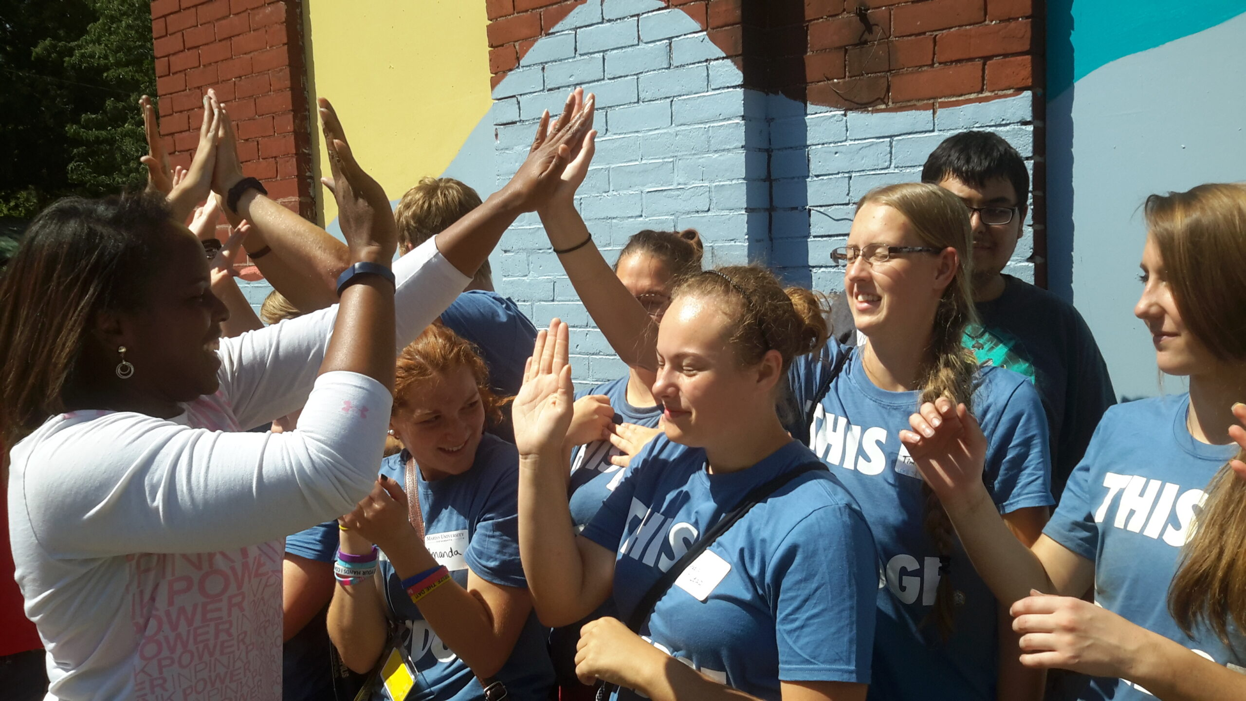 2e.Marian Students High Five 2