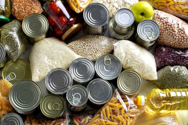 cans of food and bags of grains - top down photo