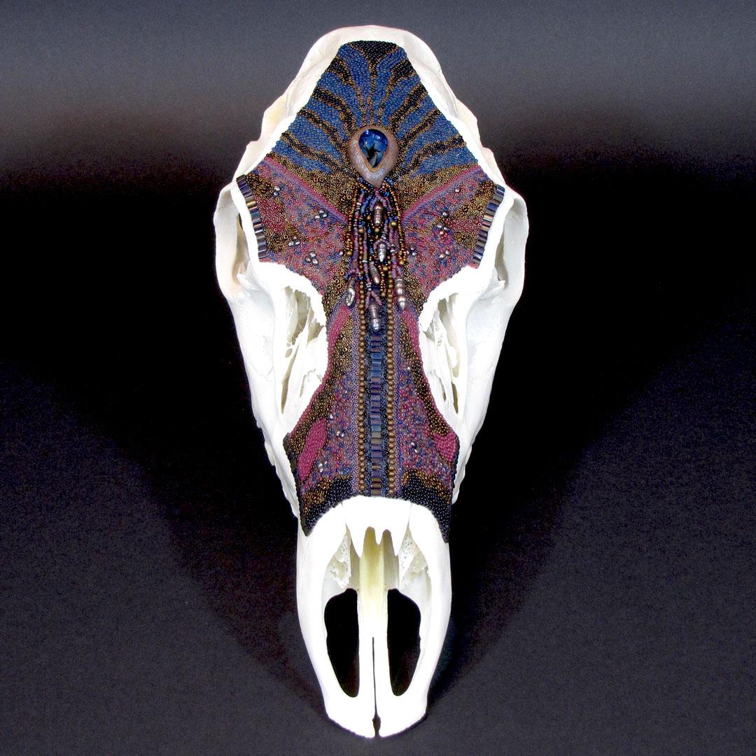 Huichol-inspired beaded elk cow skull