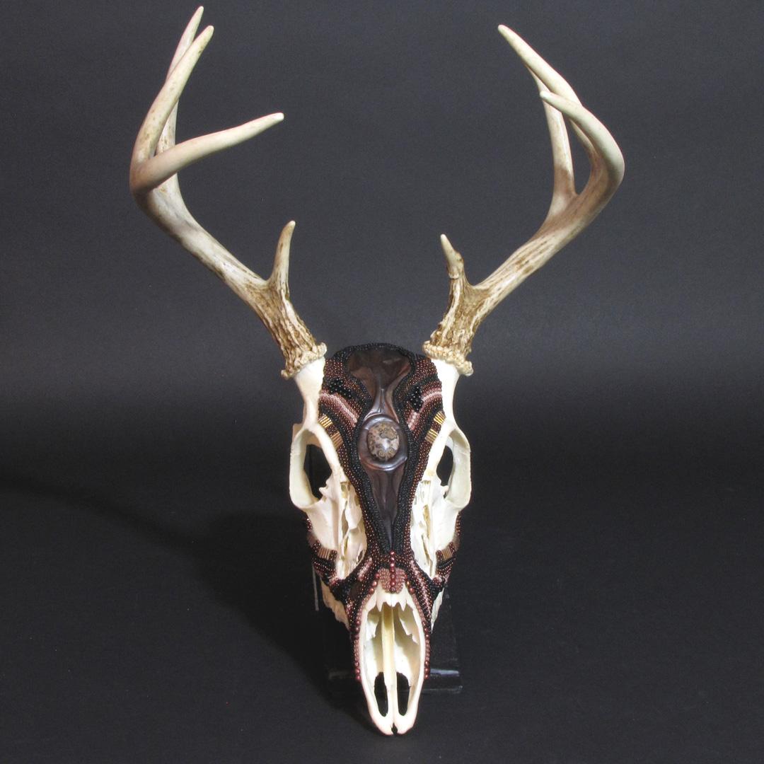Huichol-inspired beaded white tail deer skull