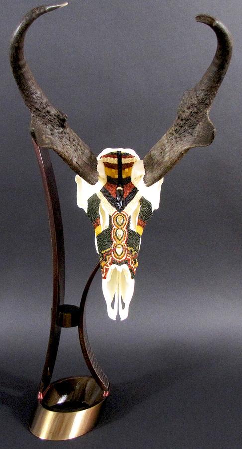 Huichol-inspired beaded pronghorn antelope skull
