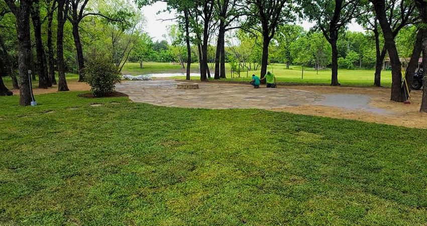 sod yard with flagstone patio sitting area
