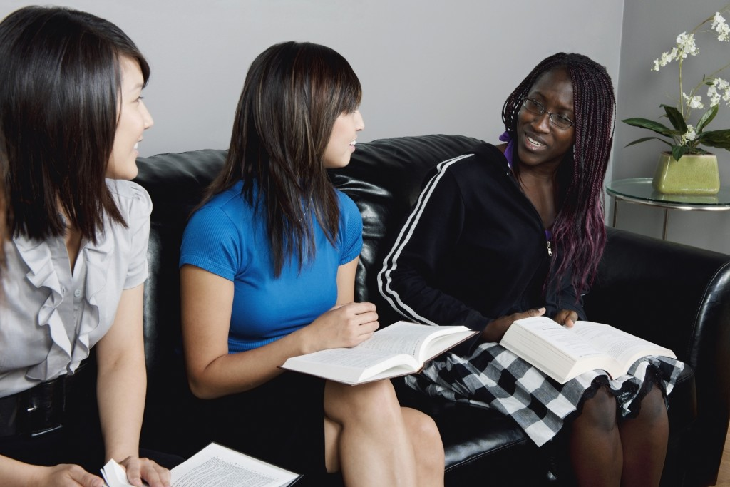 Women Talking During A Bible Study