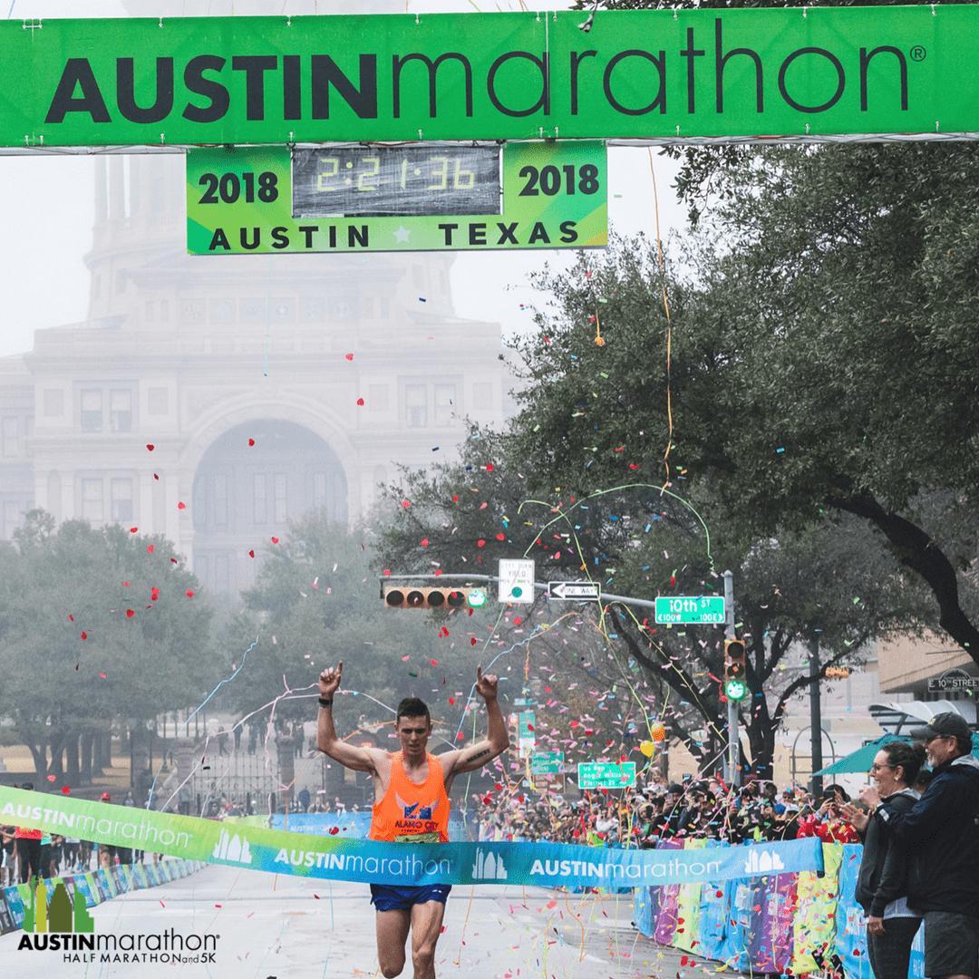 Joey Whelan crossing the 2018 Austin Marathon finish line.