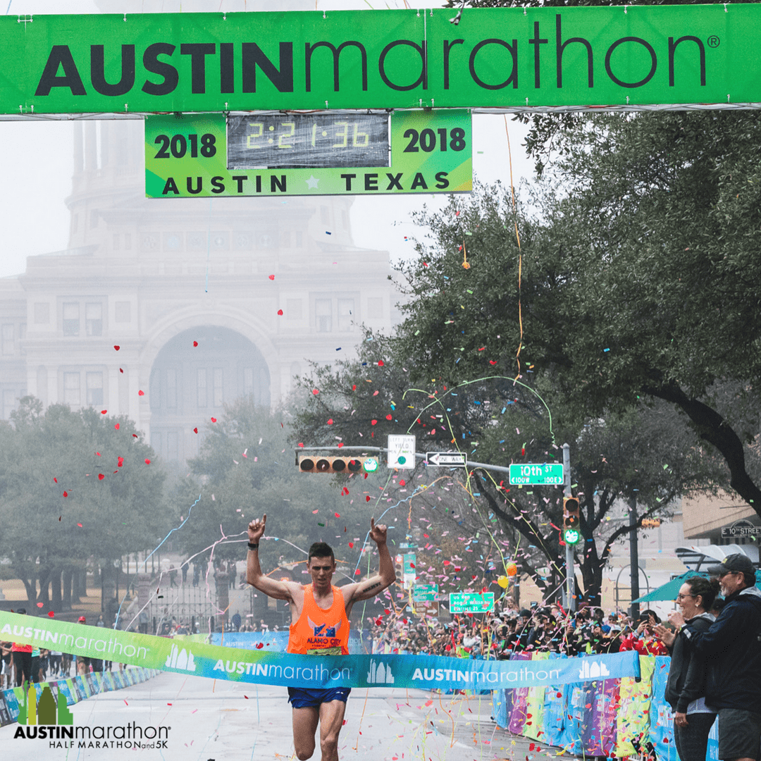 Joey Whelan crossing the 2018 Austin Marathon finish line.