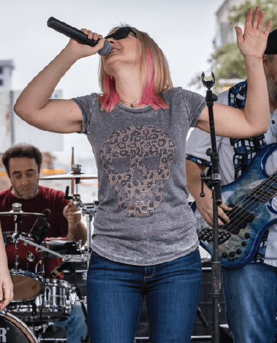 Musician preforms on the live music stage at the Austin Marathon Finish Line Festival
