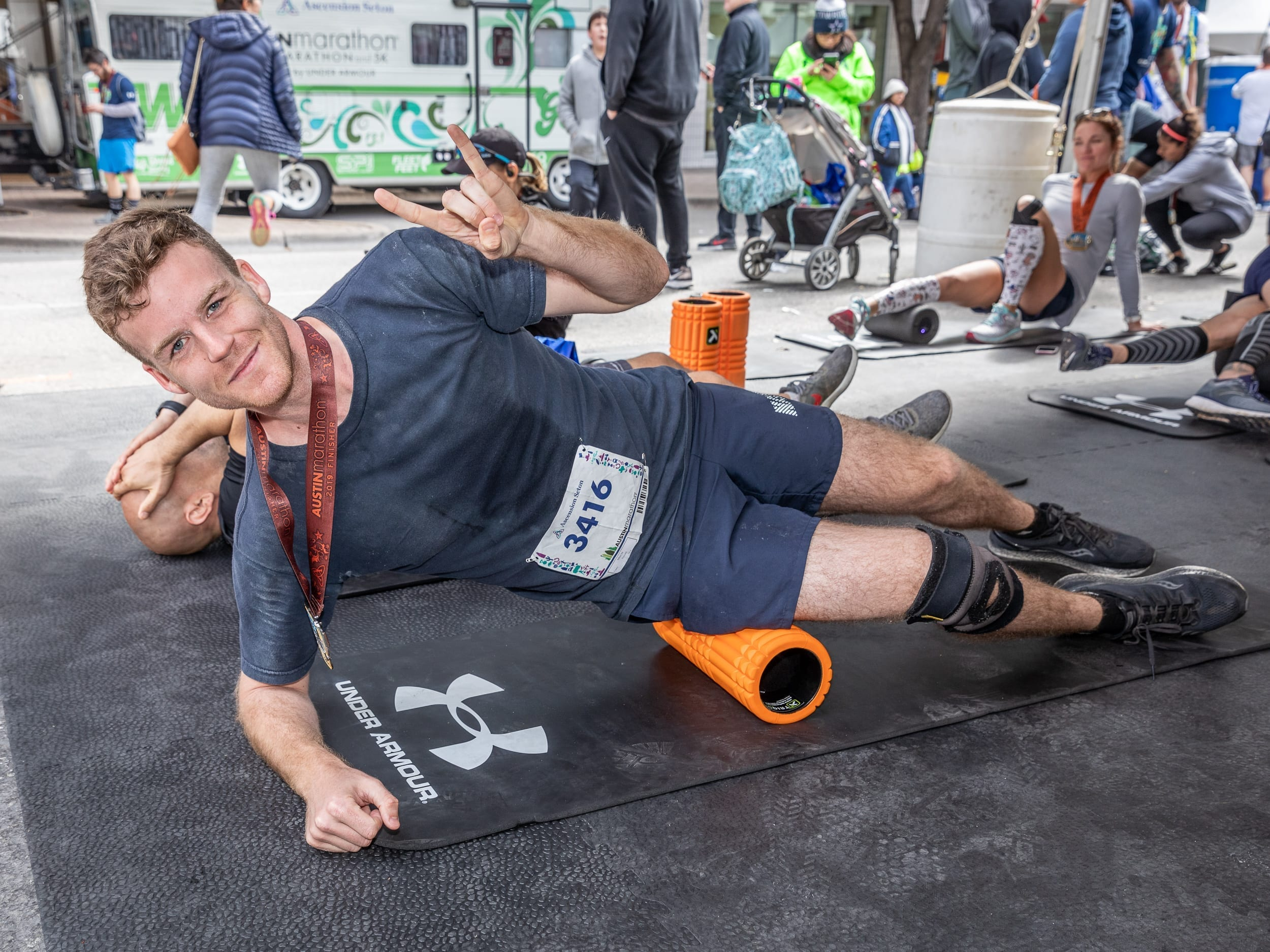 Runner foam rolls after 2019 Austin Marathon, a great tip to see improvement during training!