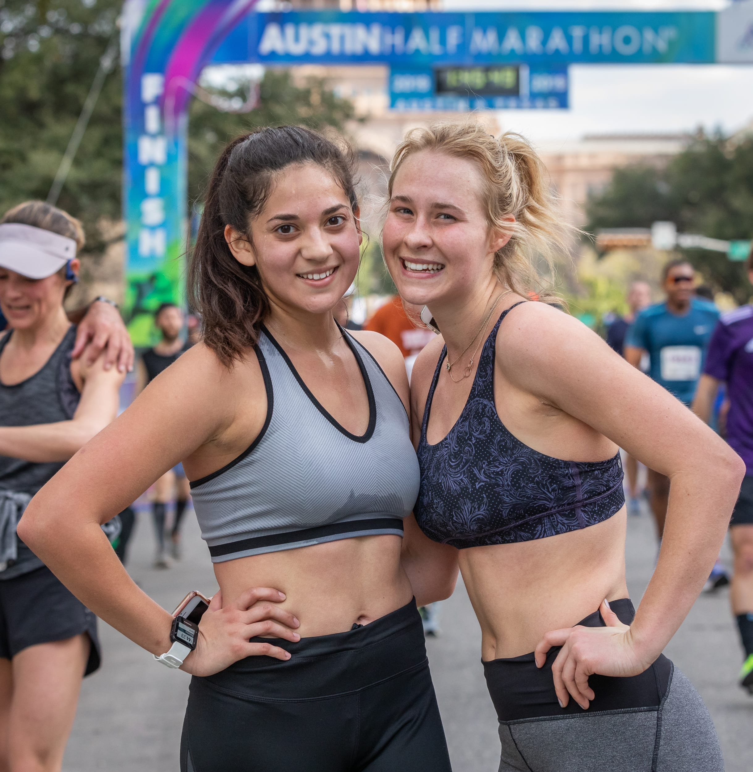 Friends pose the 2019 Austin Half Marathon finish line. Accountability is a great tip to stay motivated.