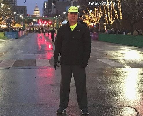 Frank Scalet, SAG driver, poses before the 2019 Austin Marathon.