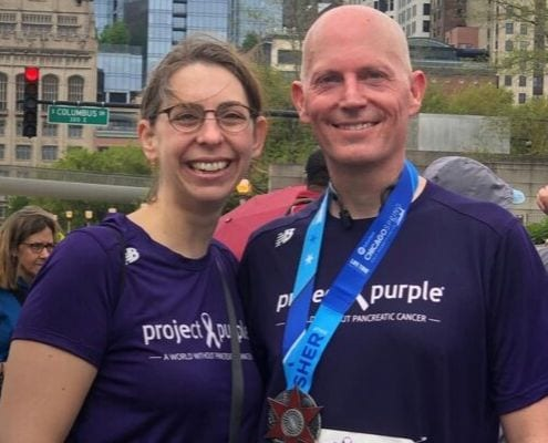 Tom and his wife, Laura, after running a race for Project Purple, a nonprofit whose mission is to find a cure for pancreatic cancer.