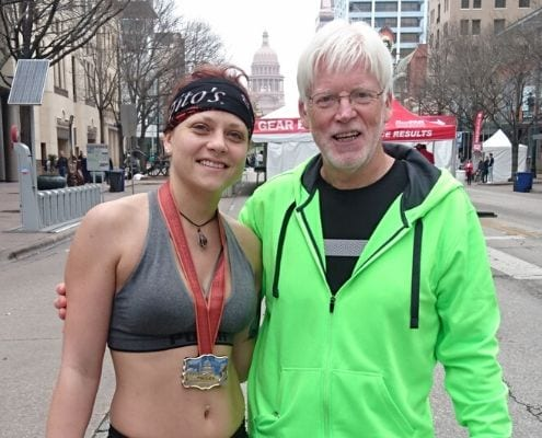 Axel Reissnecker and Anja, his daughter, after completing the 2018 Austin Marathon. Axel's love for running helped him defeat Stage IV cancer.