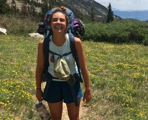Image of Blair Nagel backpacking through Colorado. Learn how running became her new routine when you ready her edition of My Running Story.