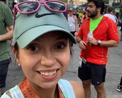 Rebecca Galvan at the 2018 Austin Half Marathon finish line, after she beat ulcerative colitis.