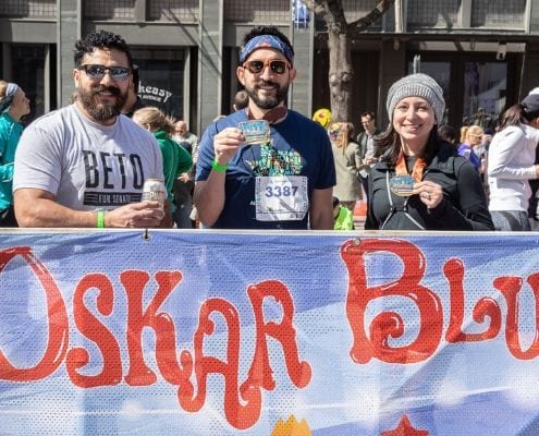 Runners celebrate at the Oskar Blues Brewery beer garden after completing the 2019 Austin Marathon.