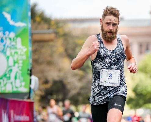 Daniel Bishop crosses the 2019 Austin Marathon finish line. He is included in the first round of elite runners accepted to the 2020 Austin Marathon elite field.