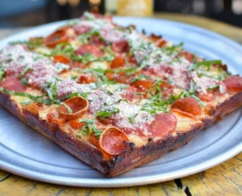 Image of a Detroit-style pepperoni pizza from Via 313. Via 313 is one of 5 Austin restaurants along the Austin Marathon course that people should visit.