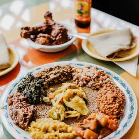 Image of several Ethiopian dishes from Aster's Ethiopian Restaurant. Aster's Ethiopian Restaurant is one of 5 Austin restaurants along the Austin Marathon course that people should visit.