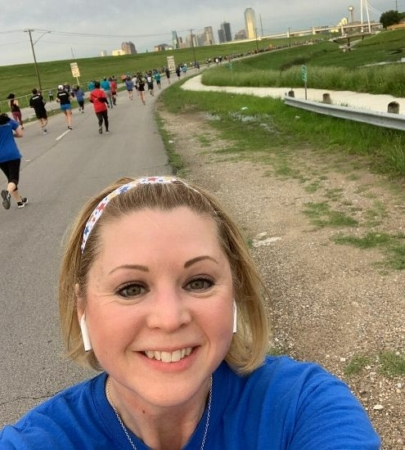 Image of Christy Thomas at a running event. She began running because she wanted to make a lifestyle change. Christy will run the 2020 Austin Half Marathon!
