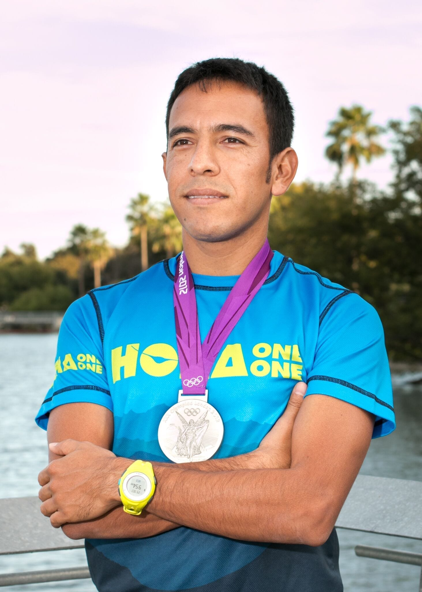 Leo Manzano, Austin Marathon Race Ambassador, poses with his Olympic silver medal. Manzano takes you back to his first sub-four-minute mile in this blog post.