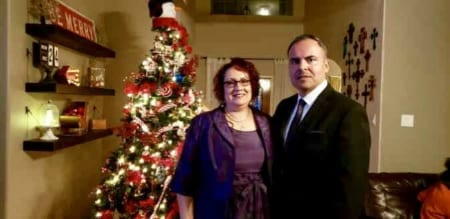 Image of Rene Arguello and Veronica, his wife, next to a Christmas tree. He's dedicating his first marathon to her!